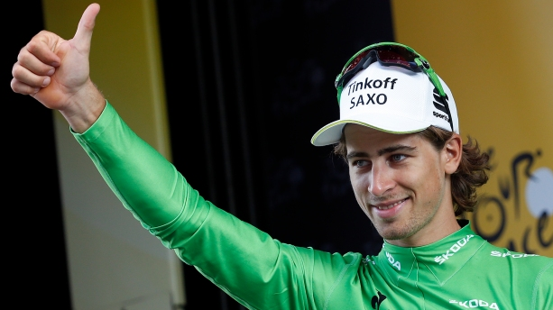 Tinkoff-Saxo rider Sagan of Slovakia gives a thumb up as he wears the green best sprinter jersey on the podium after the 16th stage of the Tour de France cycling race